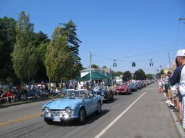 Vintage cars through downtown Watkins Glen
