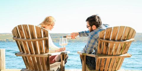 Couple drinking wine on pier