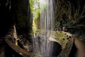 Walk behind Cavern Cascade in Watkins Glen State Park
